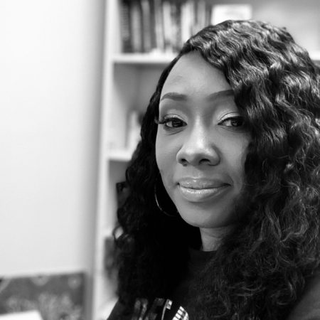black and white photo of woman in Detroit vs Everybody sweatshirt